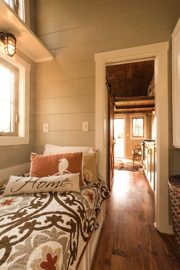 Tiny home bedroom by Timbercraft Tiny Homes