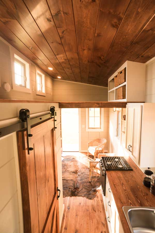 Tiny house kitchen by Timbercraft Tiny Homes