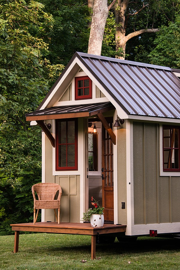 Tiny house on wheels with porch by Timbercraft Tiny Homes