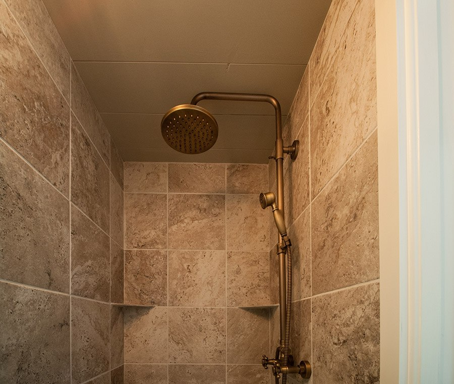 Tiny house tile shower by Timbercraft Tiny Homes