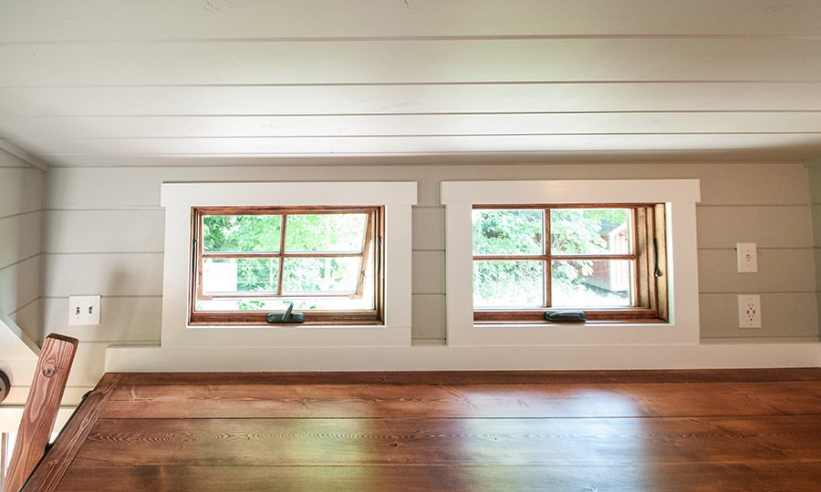 Tiny house loft windows by Timbercraft Tiny Homes