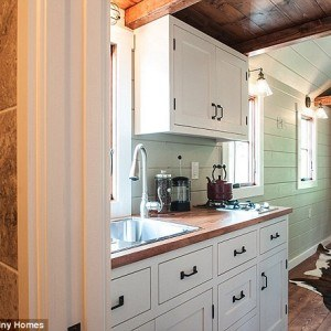 Tiny house kitchen cabinets by Timbercraft Tiny Homes