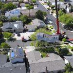 Timbercraft tiny home gets craned over house
